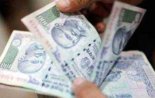 Rupee loses ground, down 11 paise against US dollar
