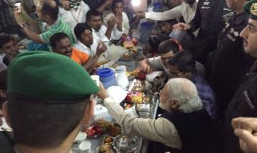 PM Modi breaks bread with Indian construction workers in Saudi Arabia