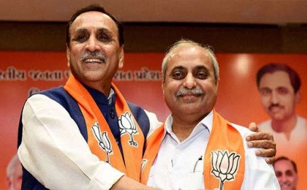 Newly elected Gujarat C M Vijay Rupani and Deputy CM Nitin Patel
