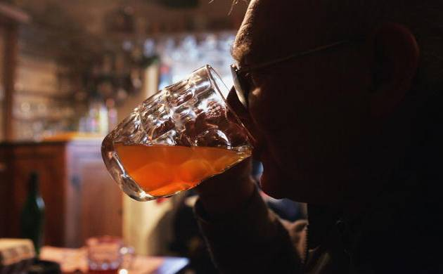 Old man drinking alcohol