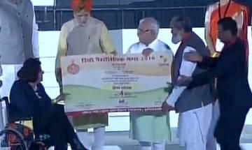 PM Narendra Modi honours Rio Paralympics Medallist Deepa Malik at Haryana Swarna Jayanti program in Gurugram