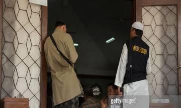 50,000 Muslim hardliners rally in Jakarta accusing Christian governor of blasphemy