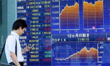 Asian markets tumble amid tight US presidential race