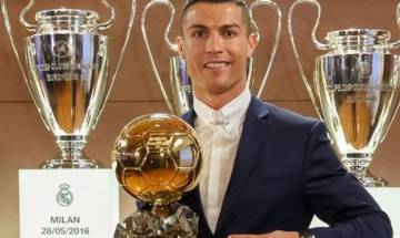 Real's Ronaldo beats Barcelona's Messi to win his 4th Ballon d'Or