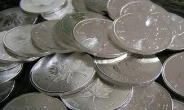 Silver loses shine by Rs 208 on profit booking