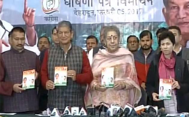 Uttarakhand polls: Congress releases manifesto in presence of CM Harish Rawat- (source: ANI)