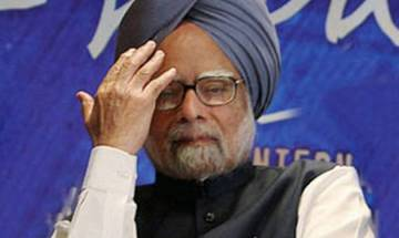 PM takes dig at Manmohan: 'No one knows art of bathing inside bathroom wearing raincoat better than him'; Cong furious, ex-PM says 'no comments'