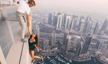 Watch: Russian Model risks life for near-death photoshoot, dangles off 1,000 ft skyscraper in Dubai