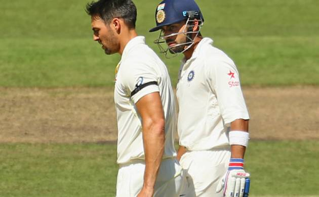 Mitchell Johnson and Virat Kohli (source; Getty)