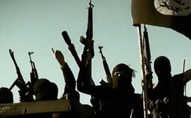 A file photo shows Islamic State militants at an undisclosed location.