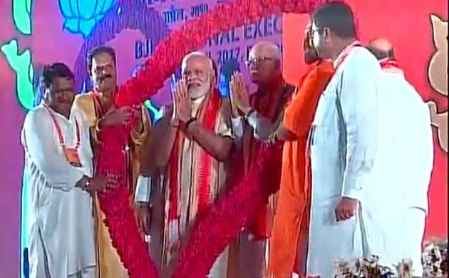 PM Narendra Modi with BJP top brass in Bhubaneshwar (Pic: ANI)