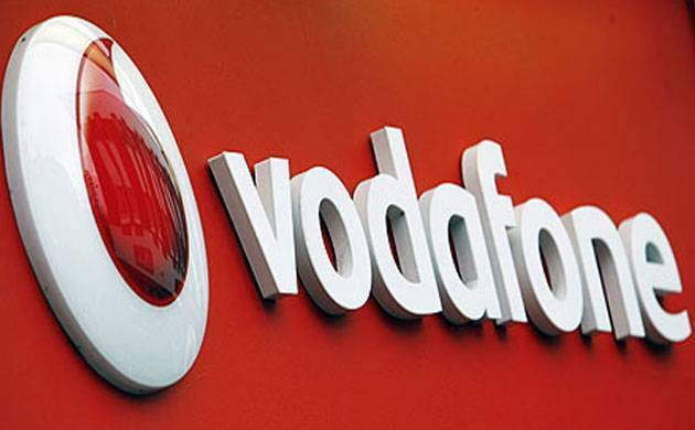 A Vodafone signboard can be seen in this file photo. The company has reported a 10.2% dip in its operating profit.