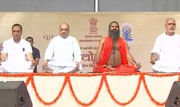 Video | International Yoga Day: Amit Shah joins Ramdev to perform yoga on a rainy day in Ahmedabad