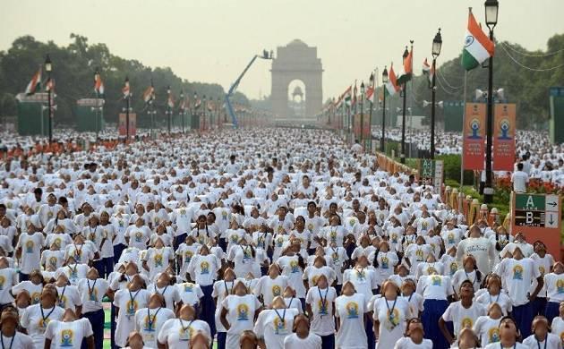 International Yoga Day: Delhiites fight rains to perform asanas (File Photo, PTI)