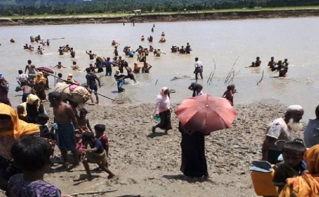 Rohingya Muslims from Myanmar fleeing to Bangladesh. (Source: Twitter/Mathew Smith)