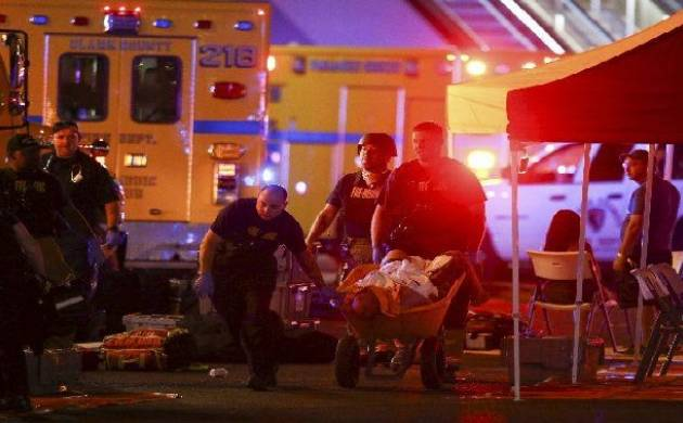Las Vegas Police persons rescue a injured on a wheelbarrow.(Source: PTI)
