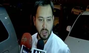 Tejashwi Yadav appears before ED in railway hotels money laundering case