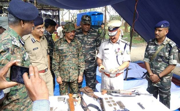 Jharkhand Police DGP DK Pandey, second from right, inspecting pistol seized after encounter with PLFI.