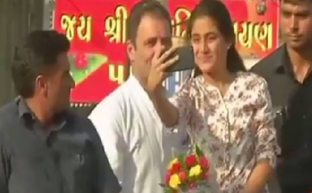 College girl clicks selfie with Rahul Gandhi during Bharuch road show. (Source: ANI)
