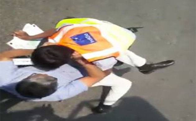 IVideo | IndiGo staff fights with passenger at Delhi's Indira Gandhi International Airport
