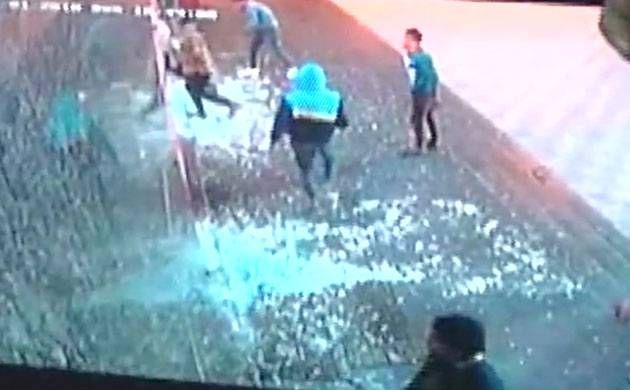 According to the eye-witnesses, a group of people opened fire and attacked the place with hammers and swords.