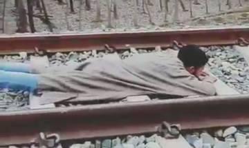WATCH | Kashmiri youth lets speeding train run over him, people demand action