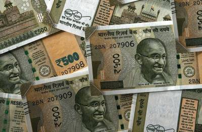 RBI sets rupee reference rate at 67.4571 against dollar