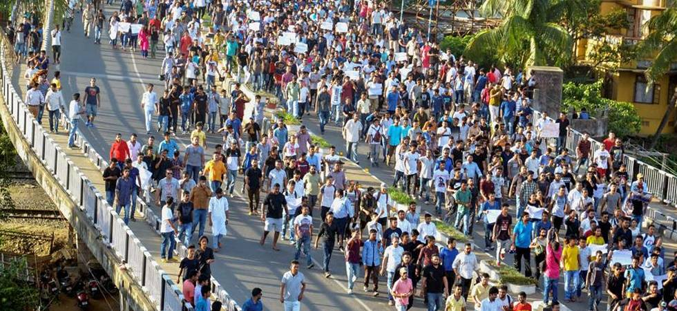 A protest march organised by several groups in Guwahati against the lynching of two men in Central Assam's Karbi Anglong district. (PTI)