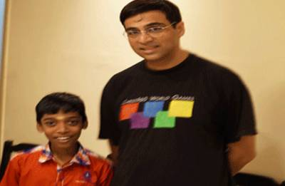 Youngest grandmaster R Praggnanandhaa exchanges ideas with Vishwanathan Anand
