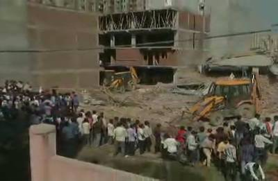 Greater Noida building collapse: Eight dead, builder arrested; rescue operation underway