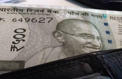 Rupee breaches again 70-mark, falls 27 paise against US dollar