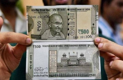 Rupee sinks 49 paise to end at lifetime low of 70.59 to US dollar