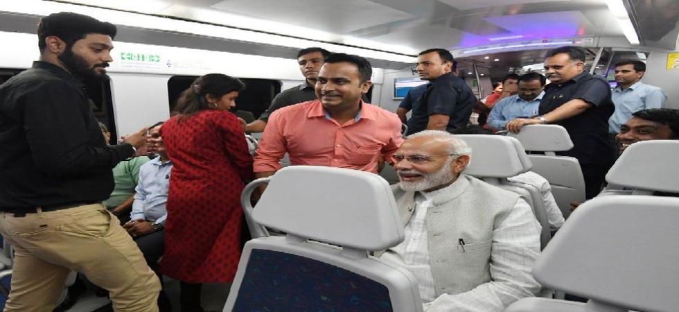 PM Narendra Modi takes Delhi metro to lay foundation stone of the convention centre.