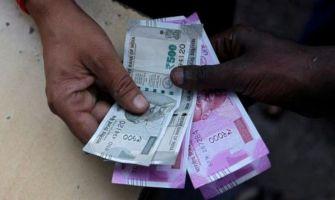 Rupee gains 6 paise against US dollar