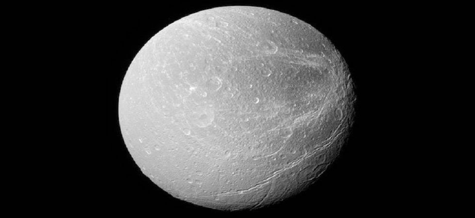 Mysterious bright stripes cover Saturn's moon Dione, scientists discover (Photo- Twitter)