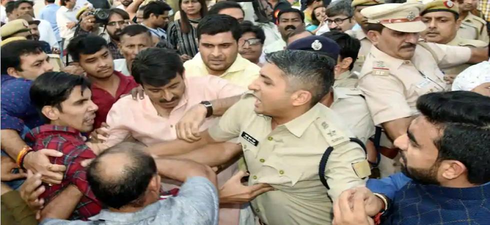 Delhi BJP chief Manoj Tiwari along with his supporters in a scuffle during the inauguration of the Signature Bridge over Yamuna River at Wazirabad in New Delhi on November 4. (PTI Photo)