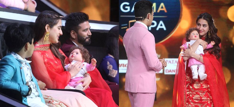 Sara Ali Khan cuddles a Taimur doll on a singing reality show/ Image: Instagram