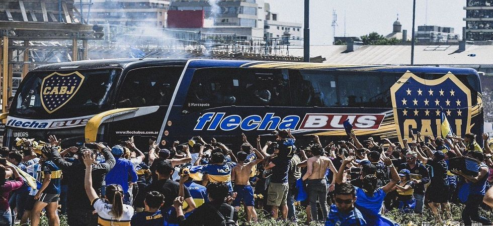 River Plate fans smashed the windows of the Boca Juniors team bus as the Copa Libertadores final was postponed yet again. (Image credit: Twitter)