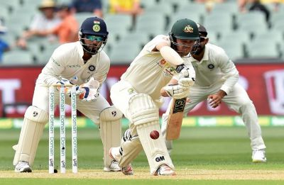 Travis Head 61* gives Australia hope after clinical bowling display by India