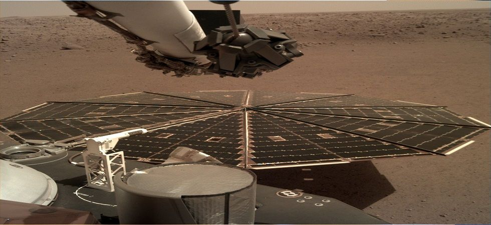 NASA releases the latest image of InSight capturing a solar panel. (NASA)