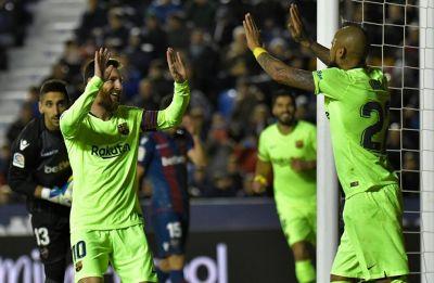 Lionel Messi hat-trick boosts Barcelona to top of La Liga table