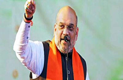 People suffering, Karnataka government busy with Cabinet expansion: Amit Shah