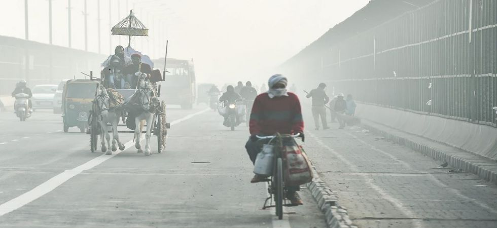 Commuters ride through heavy fog on a winter morning in New Delhi (Photo Source: PTI)