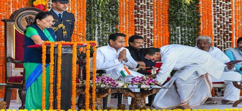Cabinet Minister Hukum Singh Karada seeks blessing from Chief Minister Kamal Nath during a swearing-in ceremony at Raj Bhawan in Bhopal on Tuesday. (PTI)