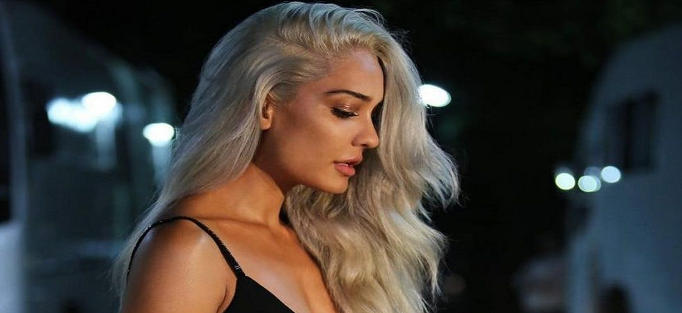 Lisa Haydon's platinum blonde hair colour is perfect for this Winter look (Photo: Facebook)