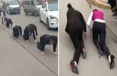 Staff at a Chinese company forced to CRAWL on the street after failing to hit their 'annual targets'