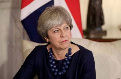 UK MPs reject chaotic 'no-deal' Brexit, back PM May's bid to reopen deal