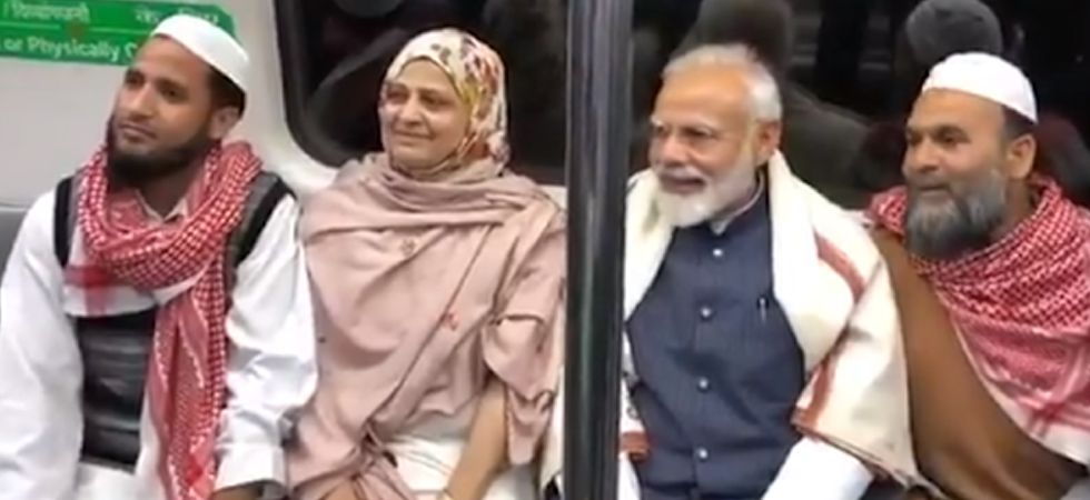 PM Modi was seen interacting with some of the commuters inside the coach. (Screengrab)