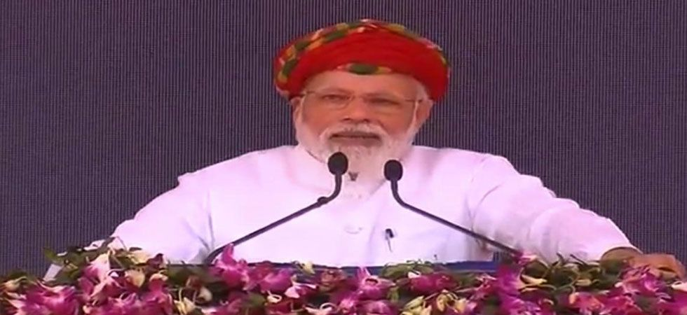 Prime Minister Narendra Modi speaking at a rally in Gujarat's Jamnagar. (Photo: Twitter/@BJP4India)