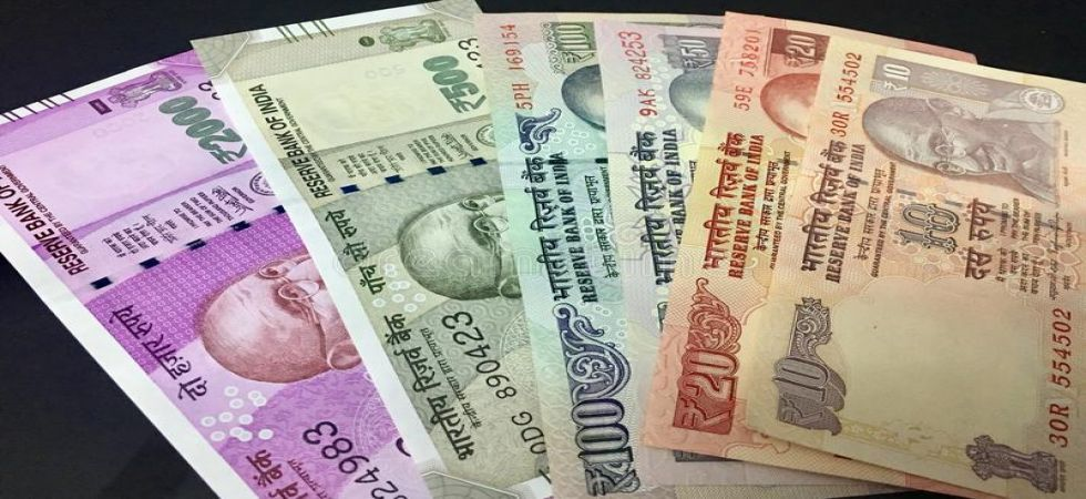 Indian rupee weakened by 22 paise to trade at 69.36 to the US dollar in early trade on Tuesday